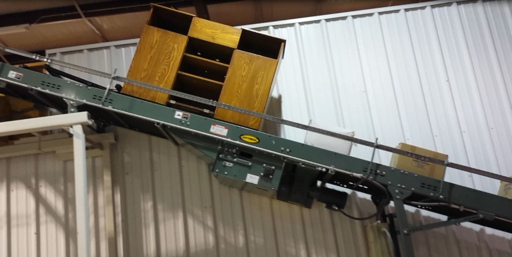 Moving boxes on the conveyor.